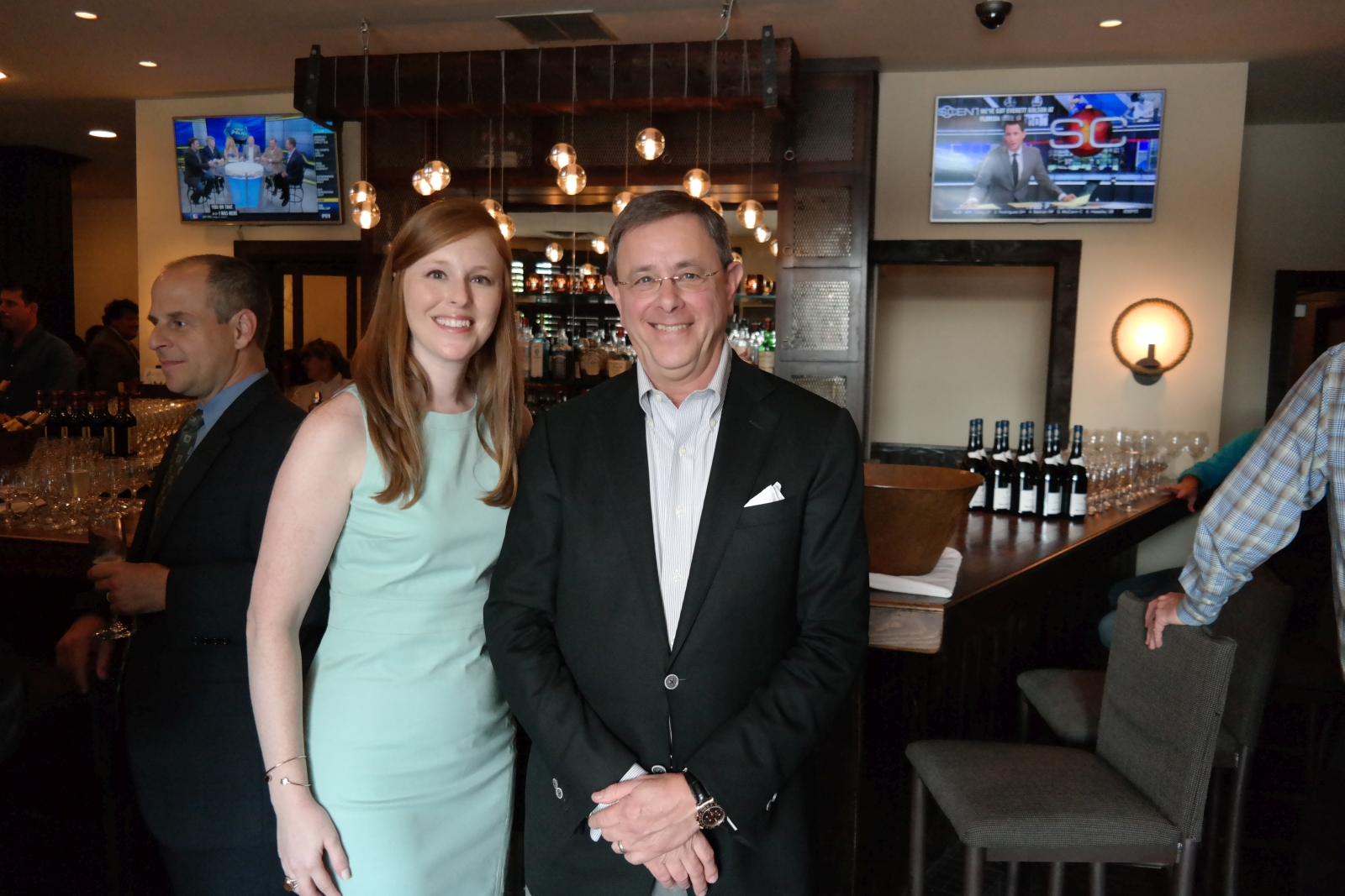 Firm attorneys Richard Glassman and Lauran Stimac at the fundraising dinner.