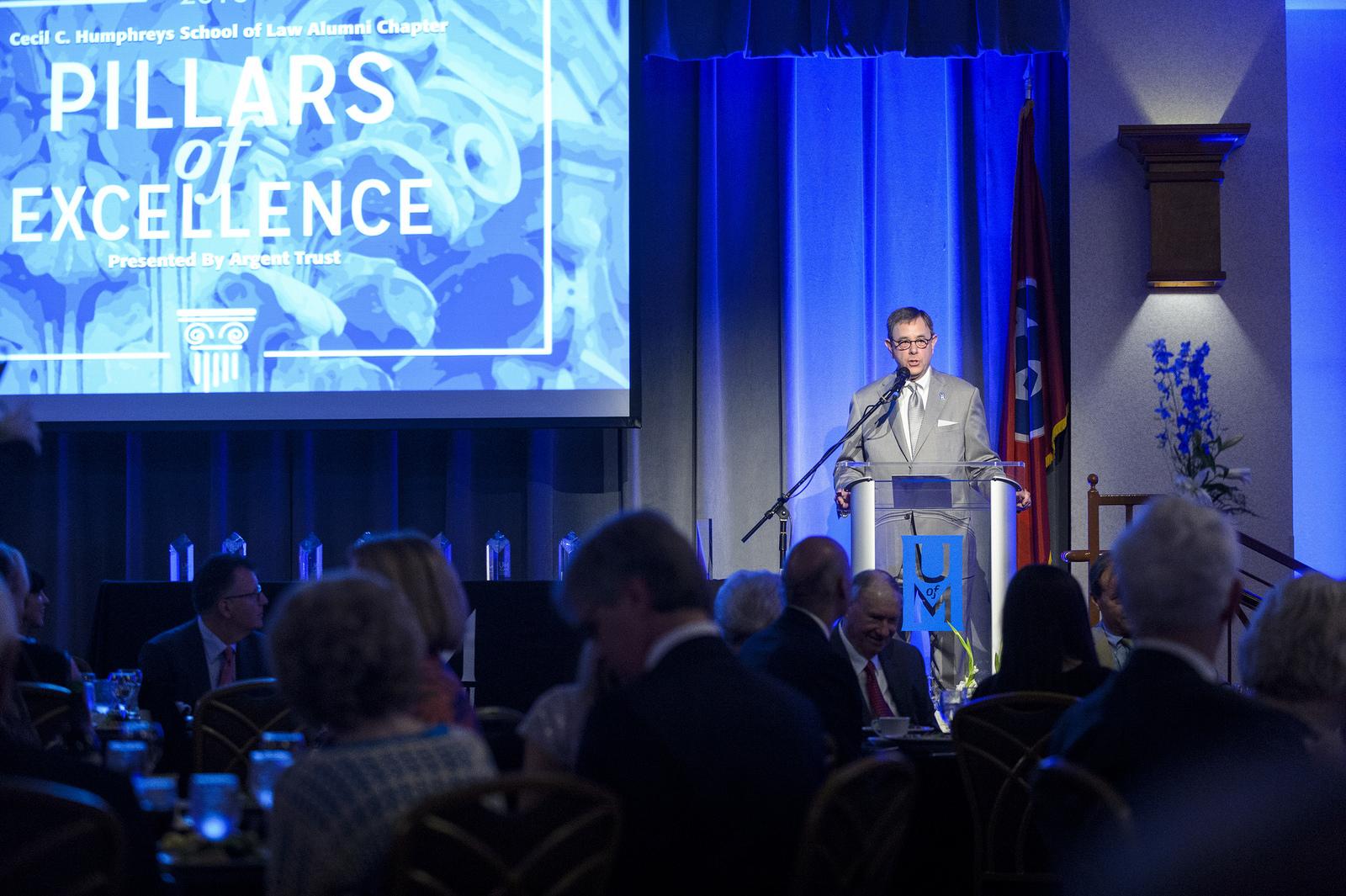 Richard Glassman presenting at podium