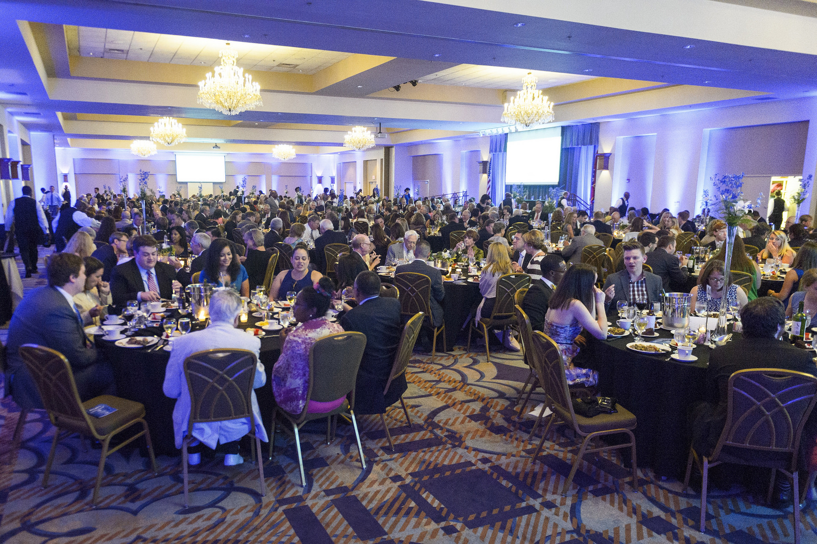 Guests eating at the Pillars of Excellence event.
