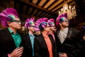 Group of men in matching mohawk wigs at the Big Wig Ball